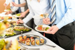 2018 Tax Law Changes may impact your next Business Lunch - people take buffet appetizers
