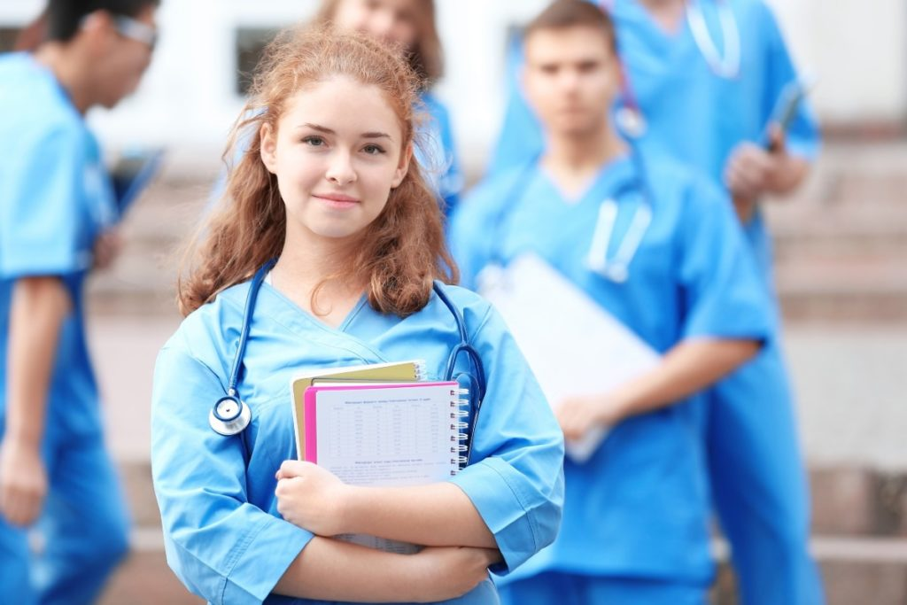 Education and Healthcare Stableford Blog female medical student holding books-web